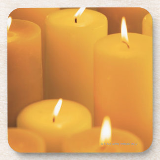 Still life of lighted candles coaster