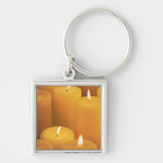 Still life of lighted candles key ring