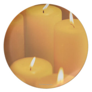 Still life of lighted candles plate