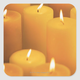 Still life of lighted candles square sticker