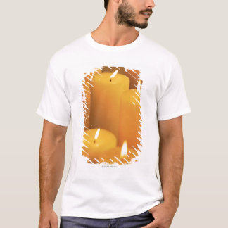 Still life of lighted candles T-Shirt