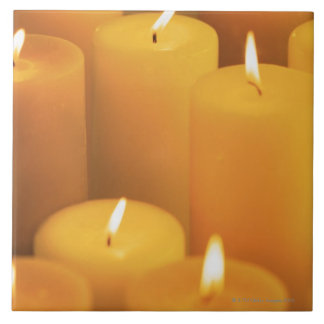 Still life of lighted candles tile