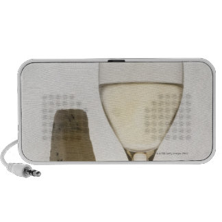 Still life of wine cheese and fig speaker system