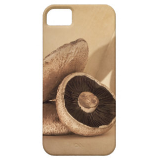 Still life with flat mushrooms and dramatic barely there iPhone 5 case