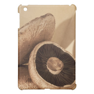 Still life with flat mushrooms and dramatic iPad mini cover