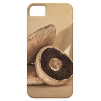 Still life with flat mushrooms and dramatic iPhone 5 cases
