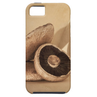 Still life with flat mushrooms and dramatic iPhone 5 cover