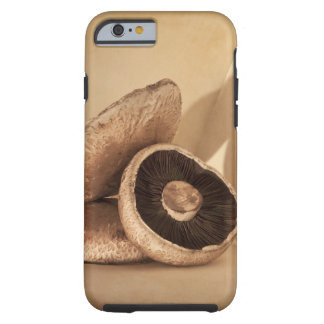 Still life with flat mushrooms and dramatic tough iPhone 6 case