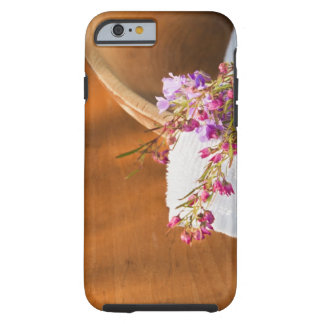 Still life with purple flowers, towel and wooden tough iPhone 6 case