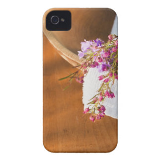 Still life with purple flowers, towel and wooden Case-Mate iPhone 4 case