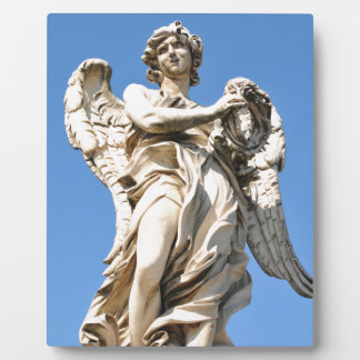 Stone angel in Rome, Italy Plaque