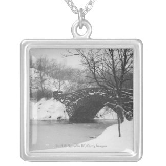 Stone bridge over snow covered river silver plated necklace