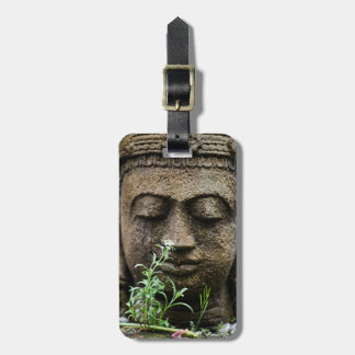 Stone garden statue with flower luggage tag