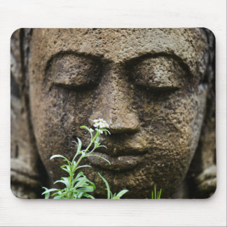 Stone garden statue with flower mouse mat