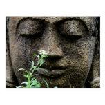 Stone garden statue with flower postcard