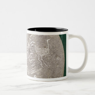 Stone inscribed with a hunter in the desert mugs
