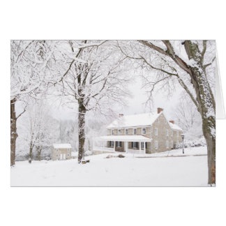 Stone mansion and Still house in snow Card