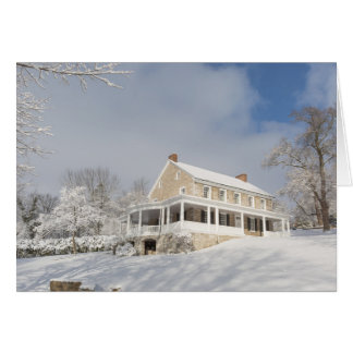 Stone mansion in snow and sunlight card
