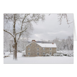 Stone mansion in snow with hills card