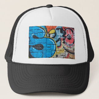 stone wall graffiti trucker hat