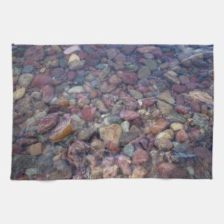 Stones in the lake at Glacier National Park Tea Towel