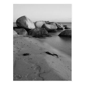 Stones into the sea postcard