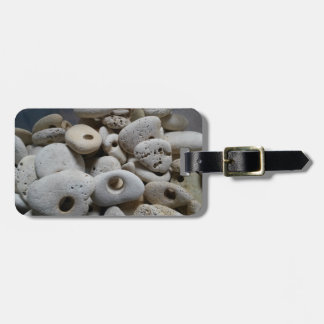 Stones with holes bag label with leather strap luggage tag