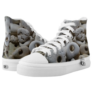 Stones with holes rocking it at the beach high tops
