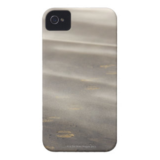 storm blowing shifting sand over boot prints 2 iPhone 4 cases
