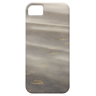 storm blowing shifting sand over boot prints 2 iPhone 5 cover