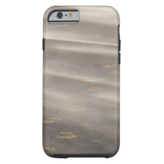 storm blowing shifting sand over boot prints 2 tough iPhone 6 case