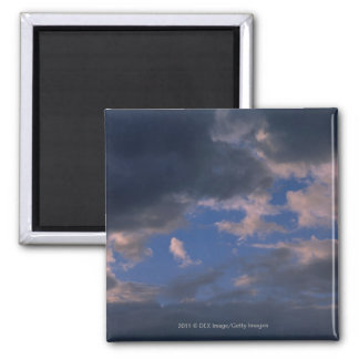 Storm clouds against blue sky square magnet