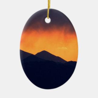 Stormy sunset ceramic oval decoration