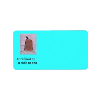Stranded on a rock at sea,( label) address label