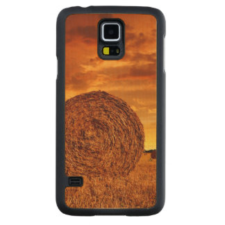 Straw bales on farmland with red cloudy sky carved maple galaxy s5 case