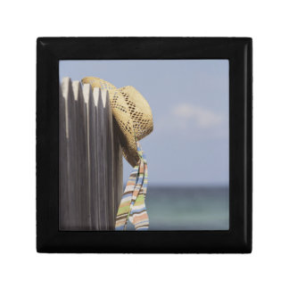 Straw Hat Hanging On Fence At Beach Small Square Gift Box