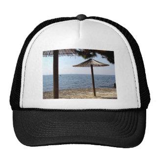 Straw Umbrellas on the Beach Trucker Hat