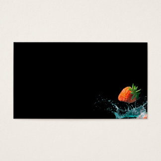 Strawberries falling into water with splashes business card