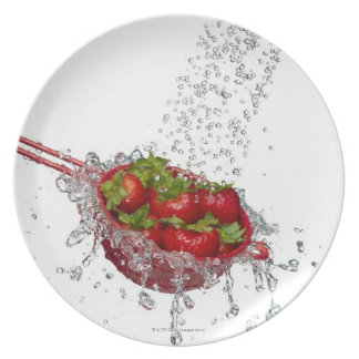 Strawberries in a red colander plate