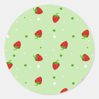 Strawberries Pattern with Green Background Round Sticker