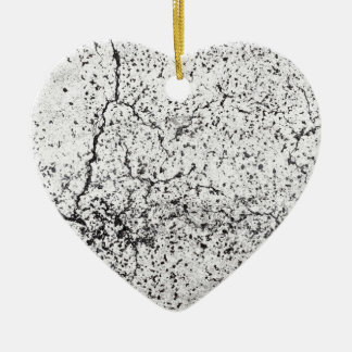 Street asphalt cracks texture ceramic heart decoration