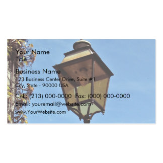 Street lamp against blue sky business card