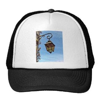 Street lamp against blue sky hats