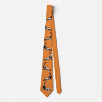 Stretching cat skeleton orange tie