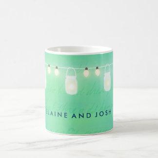 String lights and mason jars in blue green coffee mug