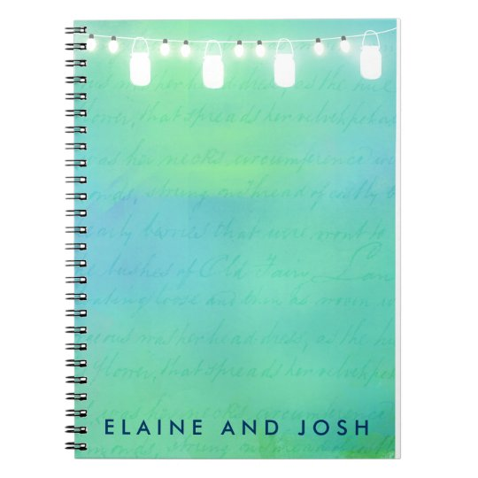 String lights and mason jars in blue green spiral notebook