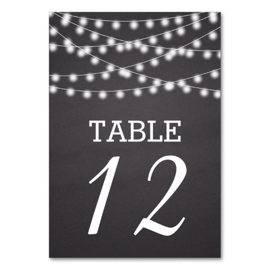 String of lights & chalkboard wedding table number