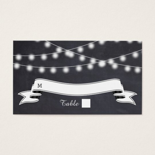 String of lights  on chalkboard wedding place card