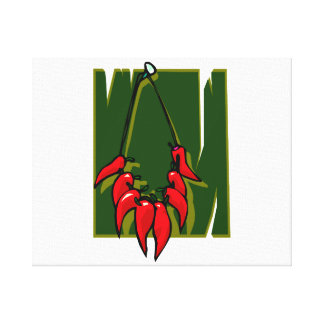 string of red peppers green back stretched canvas print