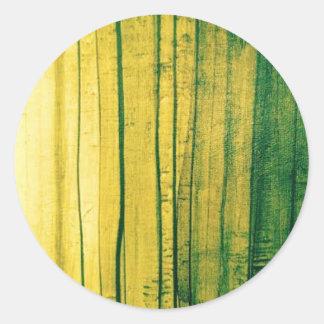 Stripey lime-green texture classic round sticker
